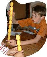 Build the highest free standing tower from approx. 15-20 Kinder Eggs (or plastic contents eggs).